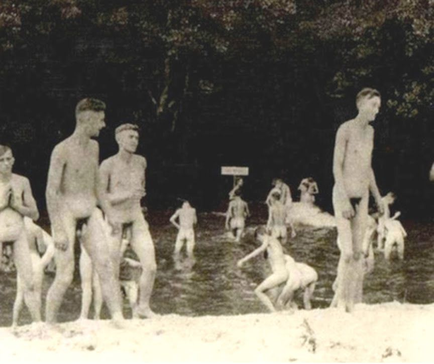 Naked young men swimming
